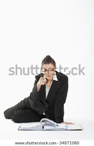 young beautiful businesswoman in suit pointing at the camera