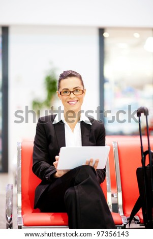 young beautiful businesswoman using tablet at airport