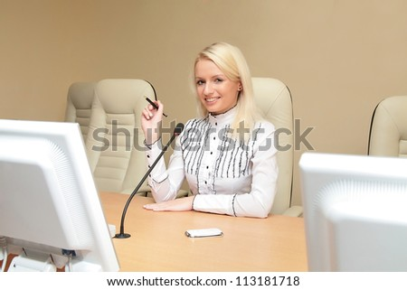 Young beautiful businesswoman working in the office