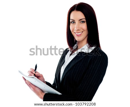 Young beautiful businesswoman writing on clipboard. Isolated against white