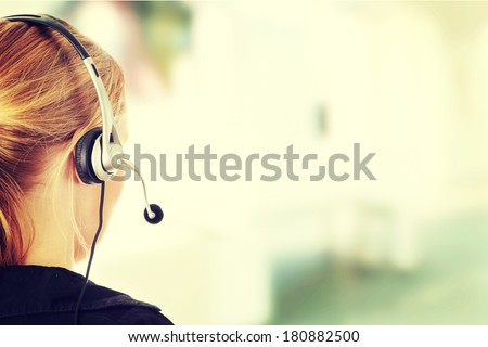 Young beautiful call center worker  - stock photo