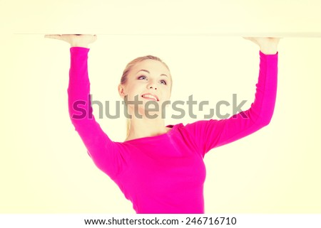 Young beautiful casual woman has empty space on her palms. - stock photo