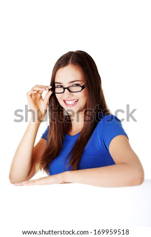 Young beautiful casual woman holding copy space. Isolated on white. - stock photo