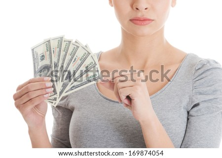 Young beautiful casual woman holding large sum of money. isolated on white.