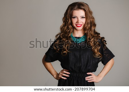 young beautiful caucasian brunette in gorgeous dress, motion shot. elegant brunette in green dress posing in the studio. Fashion photo of young magnificent woman. Girl posing. Studio photo - stock photo