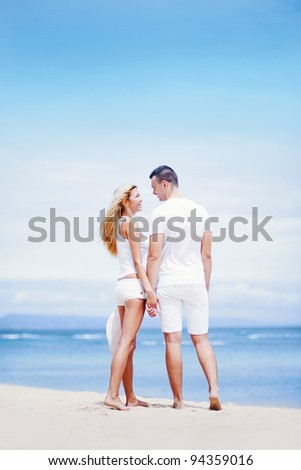 Young beautiful caucasian couple in love on the beach, bali - stock photo