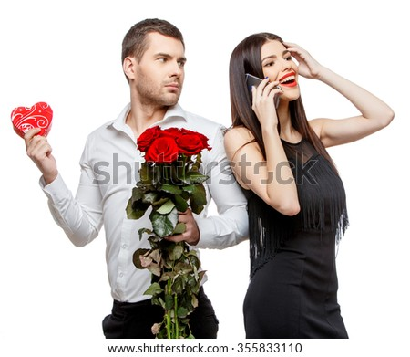 Young beautiful caucasian couple with present isolated on white - stock photo