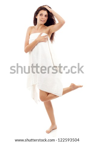 Young beautiful caucasian woman after bath full portrait isolated over white - stock photo