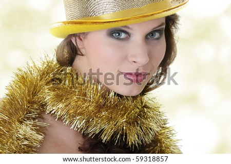 Young beautiful caucasian woman in black elegant party dress and gold hat - stock photo