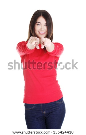 Young beautiful caucasian woman pointing on you ,isolated on white