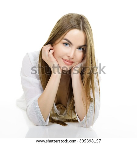 Young beautiful caucasian woman posing against white background. Studio portrait of pretty girl.