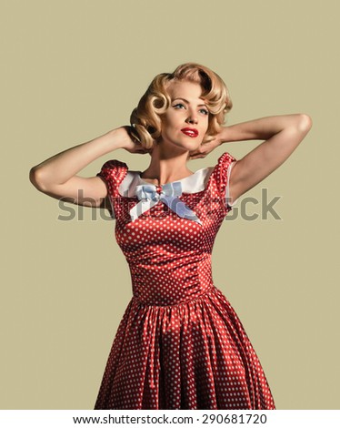 young beautiful caucasian woman posing, over dirty yellow background, retro styling, pin up - stock photo