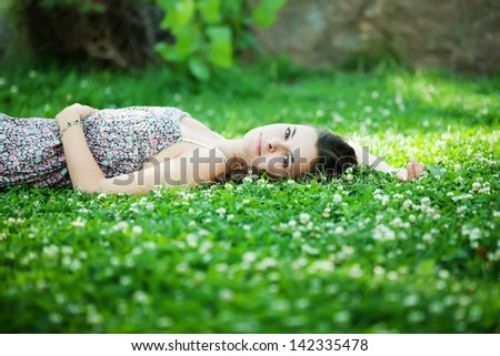 Young beautiful caucasian woman takes rest in park - stock photo
