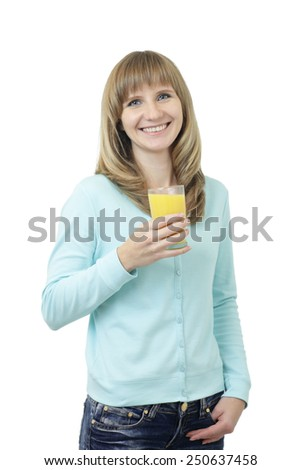 Young beautiful Caucasian woman with blue eyes waist up studio shot on white background (isolated). Looking at camera and smiling. Holding a glass of orange juice. - stock photo