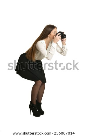 Young beautiful caucasian woman with camera over white background - stock photo