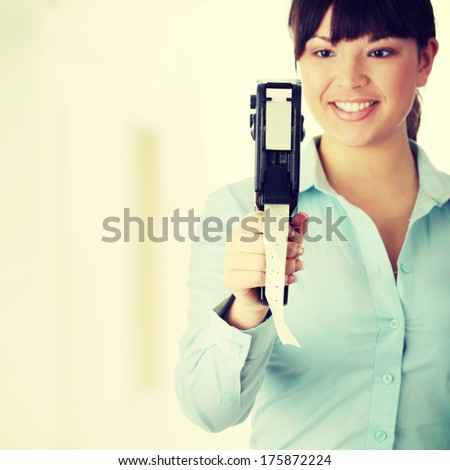 Young beautiful caucasian woman worker, setting price labels - stock photo