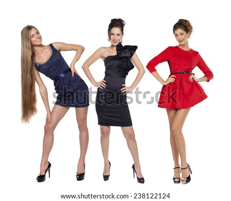 Young beautiful caucasian women in fashion gown posing on white background  - stock photo