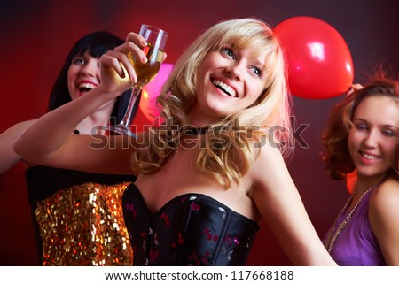 Young beautiful cheerful girl dancing at a party - stock photo