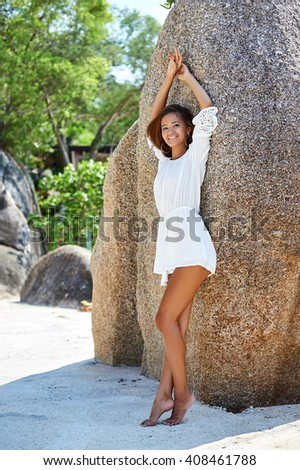 Young beautiful cheerful woman portrait - full length - stock photo