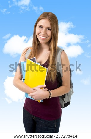 young beautiful college student girl carrying backpack and books posing happy and confident in university education and academic success concept on a clean blue sky background - stock photo
