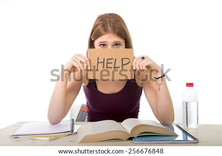 young beautiful college student girl studying for university exam in stress asking for help under test pressure sitting on desk with book in youth education concept - stock photo