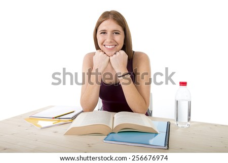 young beautiful college student girl studying happy for university exam  feeling relaxed and confident in successful youth education concept and academic success - stock photo