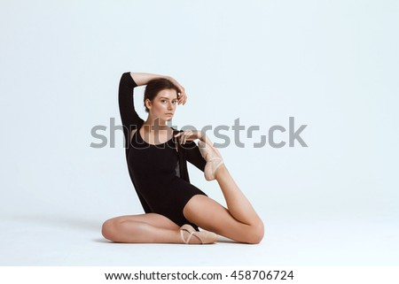 Young beautiful contemporary dancer posing over white background. Copy space.