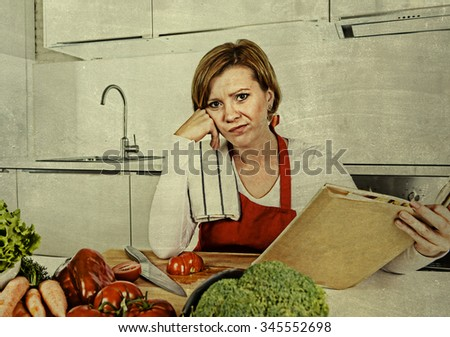 young beautiful cook woman bored and confused wearing red apron sitting at home kitchen reading recipes book bored and confused in domestic stress and lifestyle concept grunge background edit - stock photo