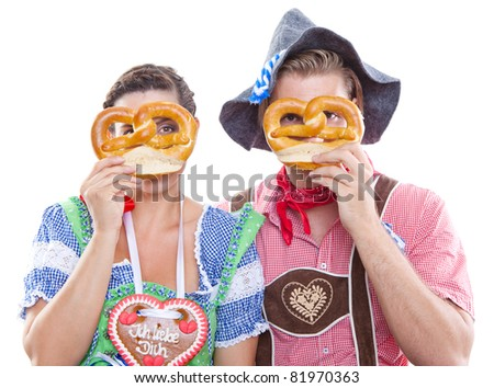 young beautiful couple at octoberfest - stock photo