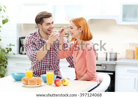 Young beautiful couple have healthy breakfast