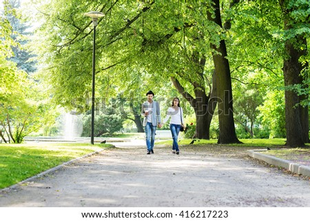 Young beautiful couple having a date in the park.