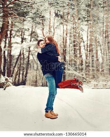 Young beautiful couple having fun outdoor. - stock photo