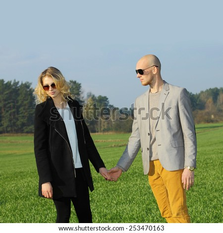 young beautiful couple having fun outdoors. Young happy couple outdoor portrait. Beautiful boy and girl have fun in the field.