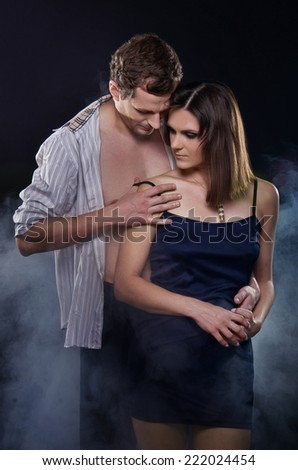 Young beautiful couple in love. Hugging each other. - stock photo