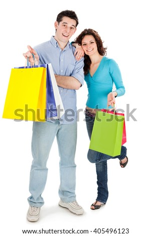 young beautiful couple in love with shop bag isolated on white