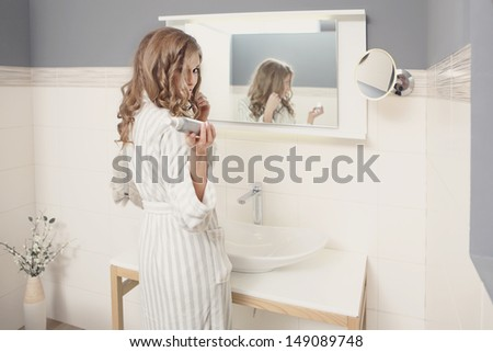 Young beautiful couple in the bathroom - stock photo