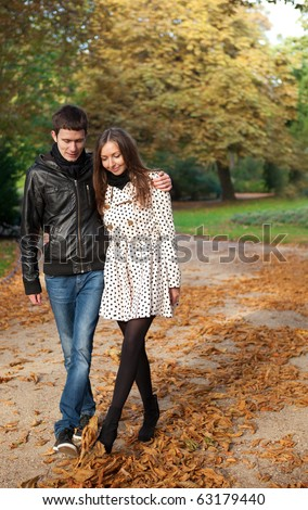 Young beautiful couple in the Luxembourg garden at fall. Paris, France - stock photo