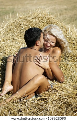 Young beautiful couple kissing - stock photo