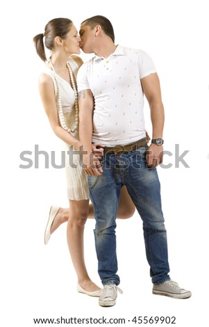 Young beautiful couple kissing isolated on white - stock photo