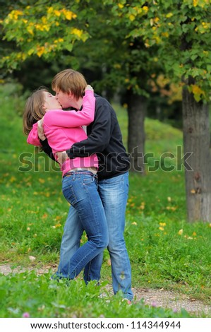 Young beautiful couple kissing oudoors