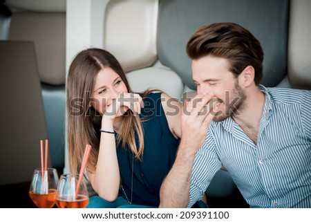 young beautiful couple lovers at the cafe - stock photo