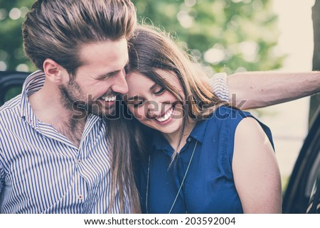 young beautiful couple lovers outdoors - stock photo