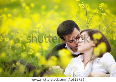 Young beautiful couple loving each other in nature. - stock photo