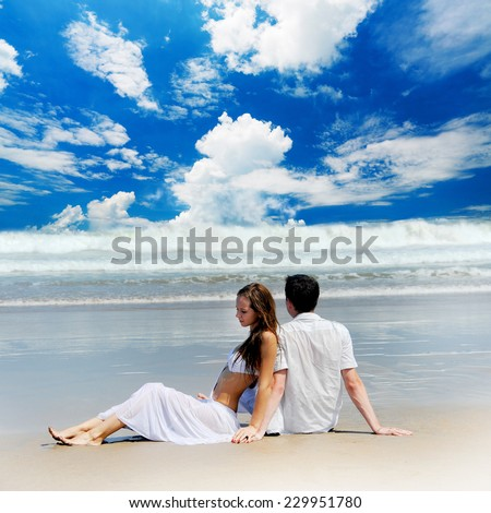 Young beautiful couple on a sunny beach