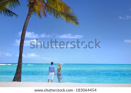 Young beautiful couple on a tropical island