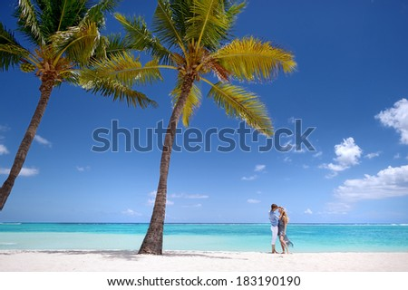 Young beautiful couple on a tropical island - stock photo
