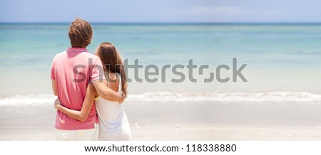 young beautiful couple on tropical bali beach.honeymoon, panoramic view - stock photo