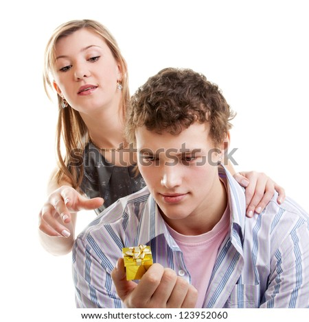 young beautiful couple with the marriage ring gift - stock photo