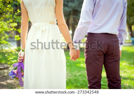 Young beautiful couple with wedding bouquet. Purple wedding.Just married. - stock photo