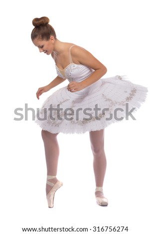 young beautiful dancer (ballerina) posing on a studio background - stock photo